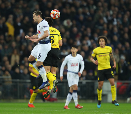 LONDON, ENGLAND - FEBRUARY 13 2019: Harry Winks of Tottenham and Thomas Delaney of Dortmund compete for the ball during the Champions League match between Tottenham Hotspur and Borussia Dortmund at Wembley Stadium, London. Editorial