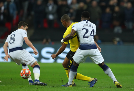 LONDON, ENGLAND - FEBRUARY 13 2019: Harry Winks of Tottenham Abdou Diallo of Dortmund and Serge Aurier compete during the Champions League match between Tottenham Hotspur and Borussia Dortmund at Wembley Stadium, London. Editorial