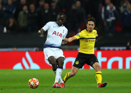 LONDON, ENGLAND - FEBRUARY 13 2019: Moussa Sissoko of Tottenham and Thomas Delaney of Dortmund compete for the ball during the Champions League match between Tottenham Hotspur and Borussia Dortmund at Wembley Stadium, London.