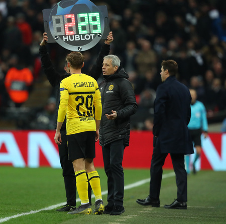 LONDON, ENGLAND - FEBRUARY 13 2019: Marcel Schmelzer of Dortmund and manager Lucien Favre during the Champions League match between Tottenham Hotspur and Borussia Dortmund at Wembley Stadium, London.