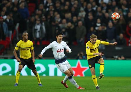 LONDON, ENGLAND - FEBRUARY 13 2019: Son Heung-Min of Tottenham and Marcel Schmelzer of Dortmund during the Champions League match between Tottenham Hotspur and Borussia Dortmund at Wembley Stadium, London. Editorial