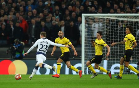 LONDON, ENGLAND - FEBRUARY 13 2019: Christian Eriksen of Tottenham takes a shot during the Champions League match between Tottenham Hotspur and Borussia Dortmund at Wembley Stadium, London.