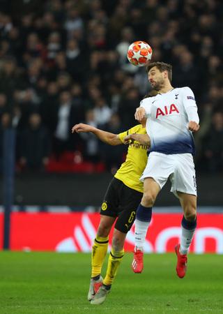 LONDON, ENGLAND - FEBRUARY 13 2019: Thomas Delaney of Dortmund and Fernando Llorente of Tottenham during the Champions League match between Tottenham Hotspur and Borussia Dortmund at Wembley Stadium, London.