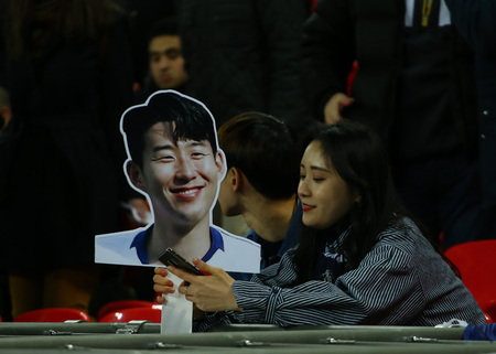LONDON, ENGLAND - FEBRUARY 13 2019: Fans with a cardboard cut-out of Son Heung-Min of Tottenham during the Champions League match between Tottenham Hotspur and Borussia Dortmund at Wembley Stadium, London.