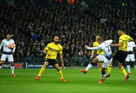 LONDON, ENGLAND - FEBRUARY 13 2019: Lucas of Tottenham takes a shot during the Champions League match between Tottenham Hotspur and Borussia Dortmund at Wembley Stadium, London.