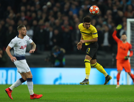 LONDON, ENGLAND - FEBRUARY 13 2019: Jadon Sancho of Dortmund heads the ball during the Champions League match between Tottenham Hotspur and Borussia Dortmund at Wembley Stadium, London.
