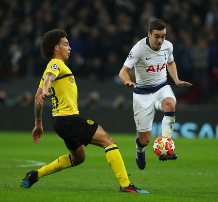 LONDON, ENGLAND - FEBRUARY 13 2019: Axel Witsel of Dortmund and Harry Winks of Tottenham compete for the ball during the Champions League match between Tottenham Hotspur and Borussia Dortmund at Wembley Stadium, London. Editorial