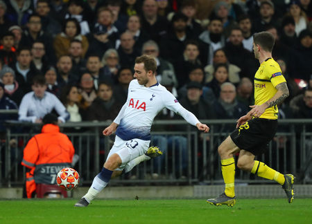 LONDON, ENGLAND - FEBRUARY 13 2019: Christian Eriksen of Tottenham during the Champions League match between Tottenham Hotspur and Borussia Dortmund at Wembley Stadium, London.