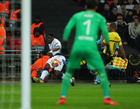 LONDON, ENGLAND - FEBRUARY 13 2019: Serge Aurier of Tottenham crosses the ball during the Champions League match between Tottenham Hotspur and Borussia Dortmund at Wembley Stadium, London.