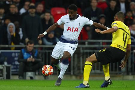 LONDON, ENGLAND - FEBRUARY 13 2019: Serge Aurier of Tottenham and Abdou Diallo of Dortmund during the Champions League match between Tottenham Hotspur and Borussia Dortmund at Wembley Stadium, London.