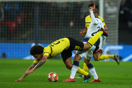 LONDON, ENGLAND - FEBRUARY 13 2019: Axel Witsel of Dortmund and Lucas of Tottenham during the Champions League match between Tottenham Hotspur and Borussia Dortmund at Wembley Stadium, London.