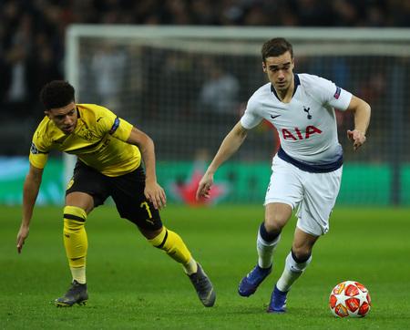 LONDON, ENGLAND - FEBRUARY 13 2019: Jadon Sancho of Dortmund and Harry Winks of Tottenham during the Champions League match between Tottenham Hotspur and Borussia Dortmund at Wembley Stadium, London.