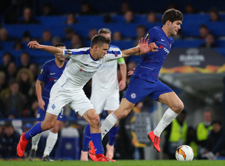 LONDON, ENGLAND - MARCH 7 2019: Volodymyr Shepelyev of Dynamo Kiev and Marcos Alonso of Chelsea during the Europa League match between Chelsea and Dynamo Kyiv at Stamford Bridge. Editorial