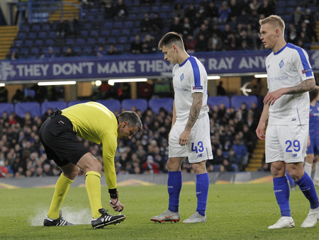 LONDON, ENGLAND - MARCH 7 2019: Referee Slavko Vincic spray marks the free kick defence line during the Europa League match between Chelsea and Dynamo Kyiv at Stamford Bridge.