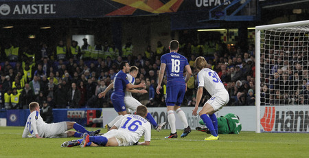 LONDON, ENGLAND - MARCH 7 2019: Goalkeeper Denys Boyko of Dynamo Kiev saves a shot from Pedro of Chelsea during the Europa League match between Chelsea and Dynamo Kyiv at Stamford Bridge.