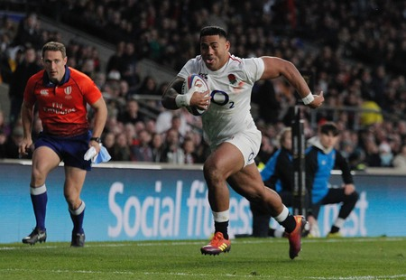 LONDON, ENGLAND - MARCH 09 2019: Manu Tuilagi of England runs through to score a try during the Guinness Six Nations match between England and Italy at Twickenham Stadium