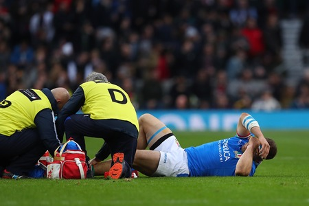LONDON, ENGLAND - MARCH 09 2019: Tommaso Castello of Italy gets treatment for an injury during the Guinness Six Nations match between England and Italy at Twickenham Stadium Sajtókép