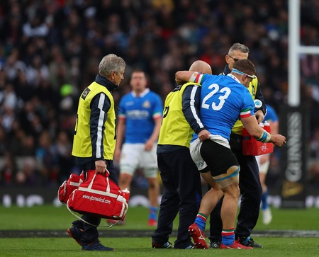 LONDON, ENGLAND - MARCH 09 2019: Tommaso Castello of Italy is helped off the field during the Guinness Six Nations match between England and Italy at Twickenham Stadium Редакционное