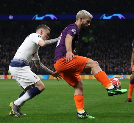 LONDON, ENGLAND: 09 MAR 2019. Kieran Trippier of Tottenham and Sergio Aguero of Man City compete for the ball during the UEFA Champions League Quarter Final, First Leg match Редакционное