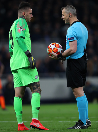 LONDON, ENGLAND: 09 MAR 2019. Ederson of Man City and Referee Bjorn Kuipers  during the UEFA Champions League Quarter Final, First Leg match