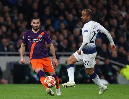 LONDON, ENGLAND: 09 MAR 2019. Ilkay Gundogan of Man City and Lucas of Tottenham compete for the ball  during the UEFA Champions League Quarter Final, First Leg match Редакционное