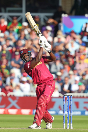 NOTTINGHAM, ENGLAND. 06 JUNE 2019: Carlos Brathwaite of West Indies plays a shot and is caught out by Aaron Finch of Australia  during the Australia against West Indies, ICC Cricket World Cup match, at Trent Bridge, Nottingham, England.