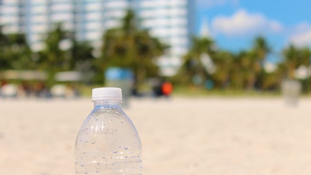 Clear Plastic Water Bottle on the Beaches of Miami, Florida Banco de Imagens - 74937818