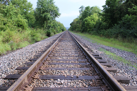 restored: Old Restored Train Tracks in the Woods Stock Photo