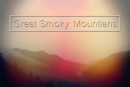 Center Letters Spelling out The Great Smoky Mountains National Park over Landscape Photography. Stock Photo