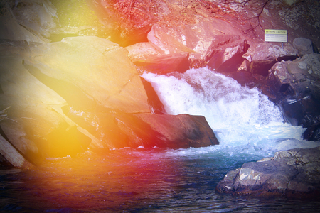 Colorful Lens Flares on a  River Rapids in the Smokey Mountains Park. Stock Photo