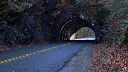 Perspective Street Photo of a Empty Tunnel Road on the Mountain Side. Stock Photo