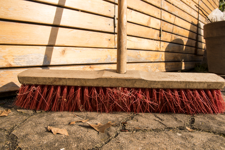 a red street broom on the sones Stock fotó