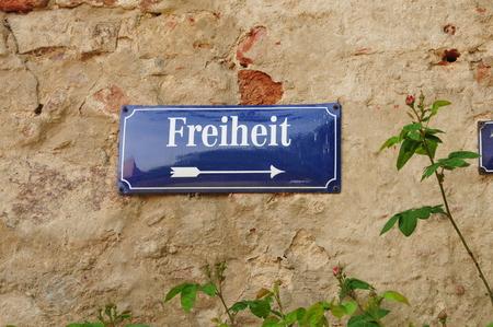 german sign at a stone wall