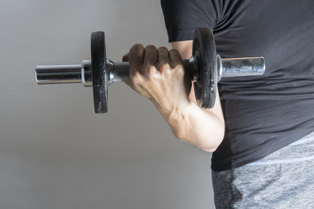 Hard work out of a woman with dumbbell