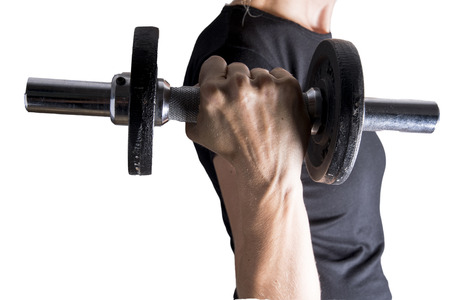 Woman is training hard with the dumbbell