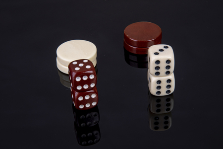 Dice game with dice and game pieces from backgammon Stock Photo