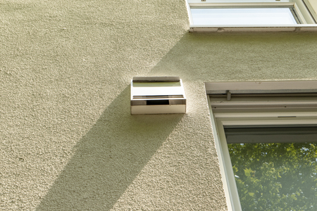 modern active ventilation system per room on the outside facade of a house Standard-Bild