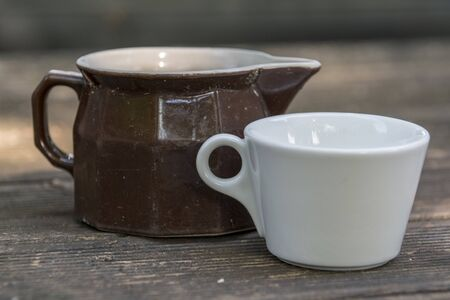 white cup and brown milk jug Stok Fotoğraf