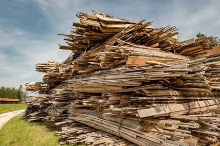 cut and stacked wood in planks cut on a meadow Stok Fotoğraf