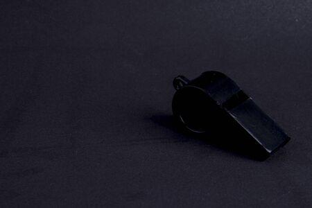 black whistle on black background