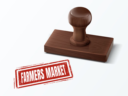 Farmers market red text with dark brown wooden stamp.
