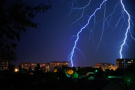 The lightning on the blue night city Stock Photo