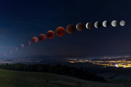 Lunar eclipse with bloody moon from its moonrise