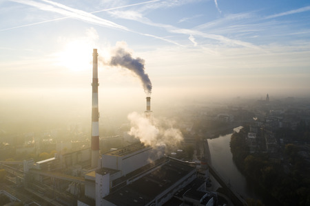 Aerial view of the smog over the city, smoking chimneys of the city. - Wroclaw, Poland Standard-Bild - 113761380