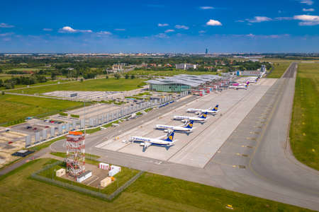 Wroclaw, Poland - June 17, 2020: Airplanes parked on airport apron in front of Wroclaw Airport terminal. Seen from high angle in front airspace radar. Photo taken from the drone Sajtókép