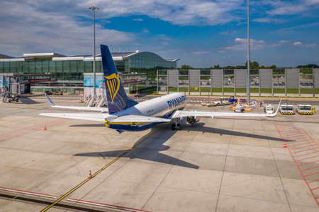 Wroclaw, Poland - June 17, 2020: Ryanair Boeing 737 airplane in front of modern Wroclaw Airport terminal. Aircrafts parked during COVID-19 european airspace lockdown. Aerial photo taken from the drone