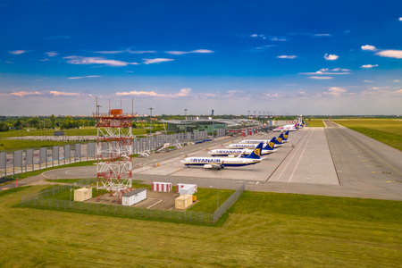 Wroclaw, Poland - June 17, 2020: Airplanes parked on airport apron in front of Wroclaw Airport terminal. Seen from low angle in front airspace radar. Photo taken from the drone Sajtókép