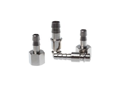 Set of steel quick couplings for hose and with thread, isolated on white background.