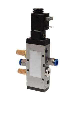 Steel alloy pneumatic solenoid switch valve with silencers and push in fittings, with the magnetic coil. Isolated on white background Stock Photo