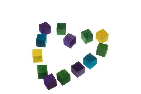 Colored wooden cubes in a heart shape for playing, building. Isolated on white 版權商用圖片